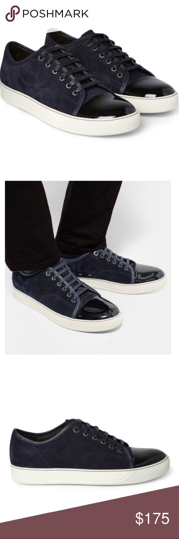 Lanvin Men's Sneakers Preloved with plenty of life left.  Lanvin's sleek suede and patent-leather Sneaker demonstrate that France's oldest couture house has a firm grip on contemporary style.  Wear this subtle two-Tone pair with cropped or cuffed trousers.  Midnight blue suede and black patent-leather.  Leather linings, rubber soles.  Lace-up.  Retail $500 at Barneys.  This style has been worn by JayZ, Ben Affleck, George Clooney, Usher, David Beckham and other celebrities.  Size 10 UK…