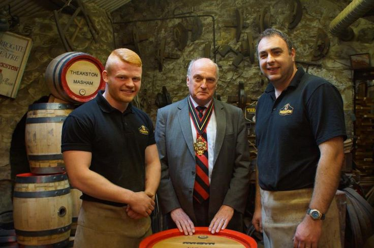 Theakston's apprentice craft brewery cooper Euan Findlay (left) with Vivian Bairstow, Master of the Worshipful Company of Coopers and Jonathan Manby, Theakston's craft brewery cooper
