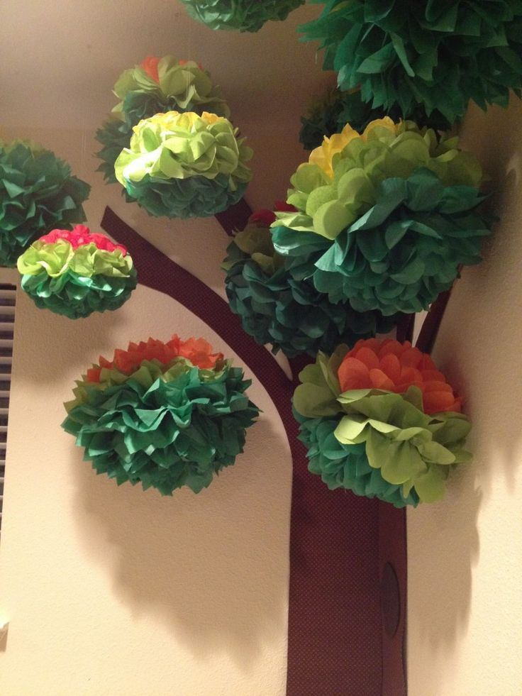 Hang the poms from clear string to create a 3D tree. I also have to give a major shout out to Lexi from the Etsy shop LadiesWhoLunchPoms for being so helpful in designing the poms with me so they looked just like tree leaves. In total, this tree cost us just $60 and makes a huge impact in the room!