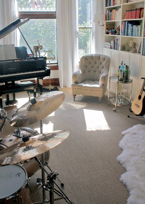 My dream music room when I get my own place, just image a huge bean-bag in place of the vintage chair... and a pug sat on it