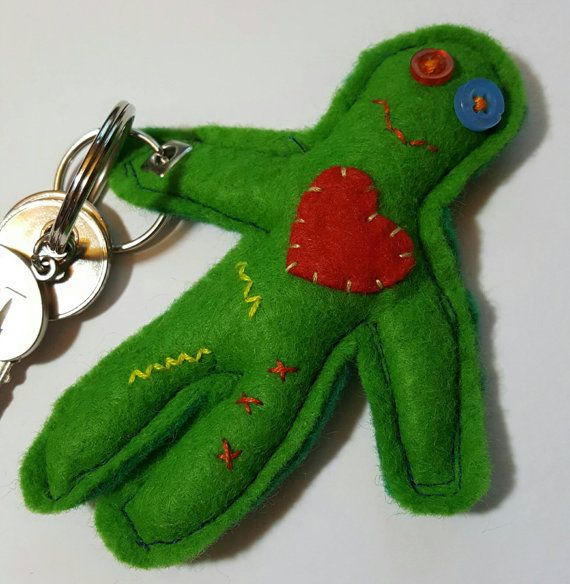 Please note this item is on sale due to small imperfections. He is still fully functional and very loveable! Please ensure you read the listing fully as refunds will not be issued on sale items. This is a hand sewn felt keyring in the shape of a zombie. His name is Harry and he enjoys holding keys or hanging out on bags. Dont worry, Harry is now fully vegetarian so no brains are required. This item measures approximately 11 cm x 9cm. The little zombie has an appliqué heart, button eyes and…