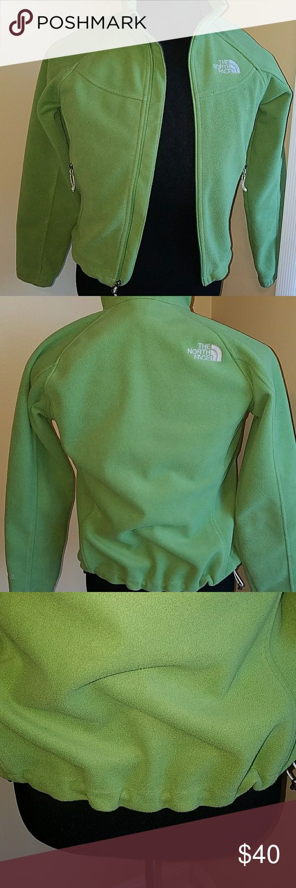 The North face fleece jacket(SALE) Pre-owned good condition North face fleece jacket a size small for women very cute no tears no rips no stains it has a gathered waist at the bottom it has two long pockets on each side zipper closure on the front. Size s/p super cute check pictures above. The North Face Jackets & Coats Utility Jackets