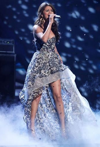 selena gomez performing  A YEAR WITHOUT RAIN