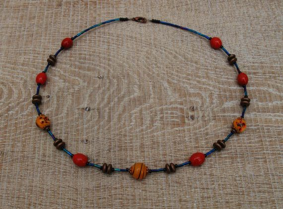 Burnt orange ochre and midnight glass by BijoubeadsLondon on Etsy £23.00