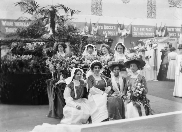 Soldiers in petticoats: Suffragette leader Emmeline Pankhurst (front row, third from left), at the flower stall of the Women's exhibition, London, May 1909