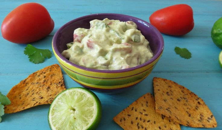 Lightened Up Guacamole - A creamy, healthy dip made with avocados, greek yogurt, tomatoes, jalapenos and seasoning.  42 calories 1/4 cup!