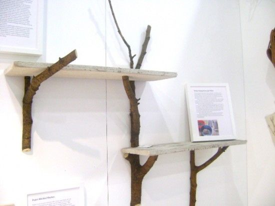 Need somewhere to store all of those antique books? Using branches as shelf supports will create a woodland in your living room
