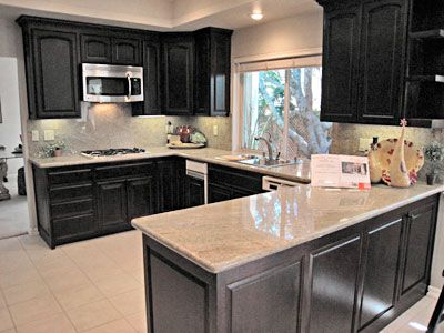 Kitchen Cabinets Countertops on Stained Cabinets And Granite Counters And Ss Appliances Make It New