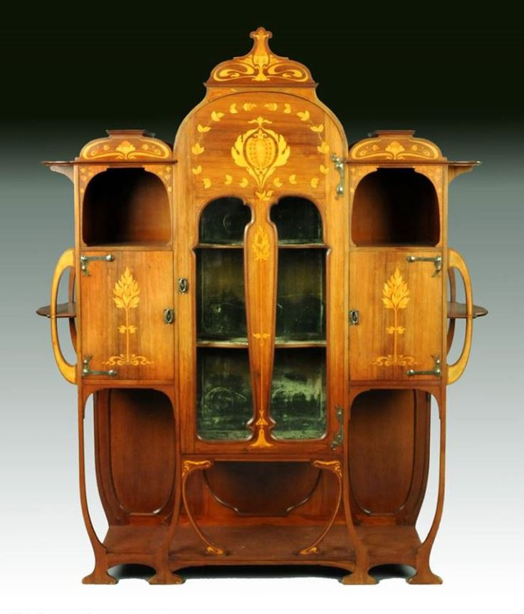 An Art Nouveau inlaid mahogany cabinet by Christopher Pratt & Sons, Bradford England circa 1910.