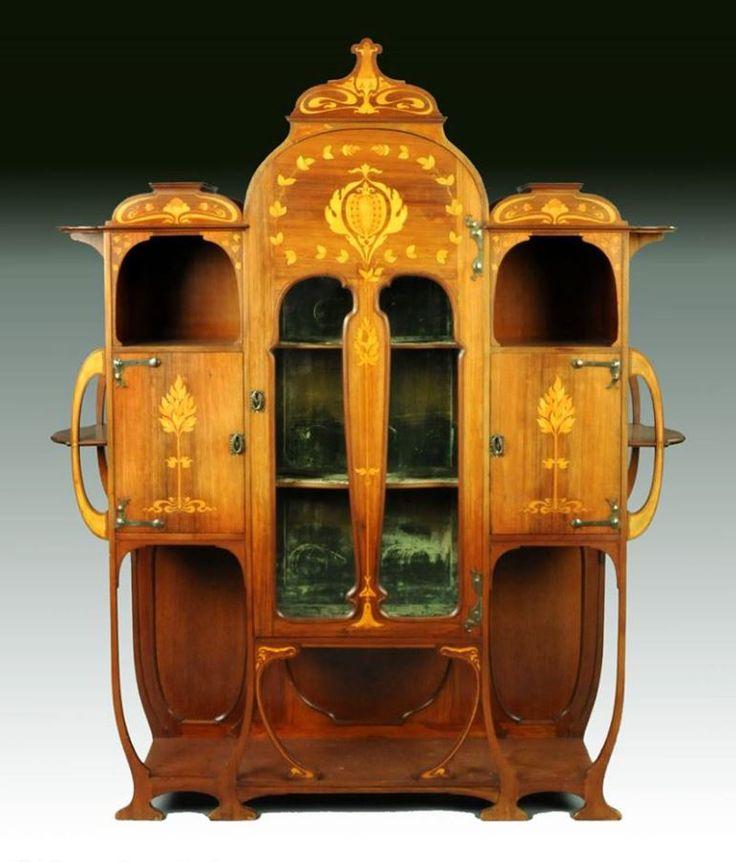 An Art Nouveau inlaid mahogany cabinet by Christopher Pratt & Sons, Bradford England circa 1910.