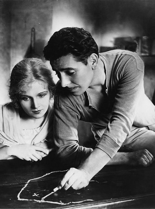 "matineemoustache: "" Ann Harding and Ronald Colman plot their escape in Condemned (1929) """