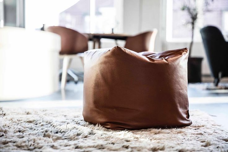 Otto pouf in soft cognac coloured aniline leather - a cosy little piece of furniture.  #puf #læder #stue #boligindretning