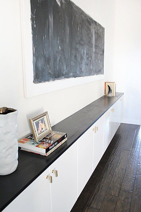 """DIY Furniture: 8 Favorite IKEA """"Fauxdenza"""" Tutorials - IKEA cabinets look extra expensive with ebony-stained wood and gorgeous  - bought brass handle - Akurum cabinets 36"""" wide x 24"""" high with white high gloss Abstrakt doors."""