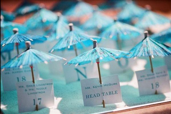 escort cards - fun for a destination wedding on the beach