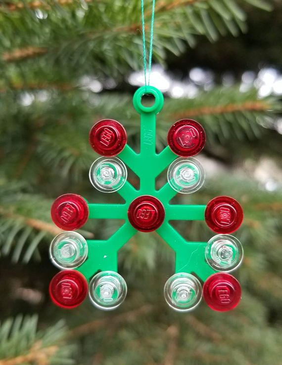 This cute ornament is sure to brighten up your tree! Measuring 2 in tall and 1.5 in. wide, this ornament is a great addition to any Christmas tree. The pieces of this ornament are glued together and will not come apart. **Color and type of ribbon/string may vary.  This decoration