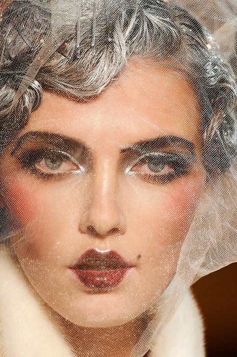 HAIR/MAKEUP - This John Galliano look is an exaggeration of the desired beauty look in the 1920's.
