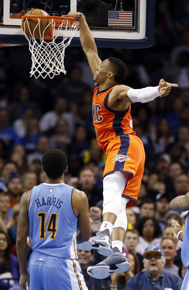 Oklahoma City's Russell Westbrook (0) dunks the ball during the fourth quarter of an NBA basketball game between the Oklahoma City Thunder and the Denver Nuggets at Chesapeake Energy Arena on Dec. 27, 2015 in Oklahoma City, Okla. Photo by Steve Sisney, The Oklahoman