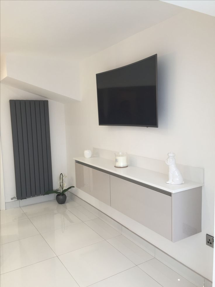 The floating Media Unit by Purple Kitchens in Liverpool using our Zurfiz UltraGloss Cashmere doors.