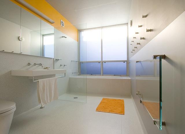 Orange and white minimalist bathroom