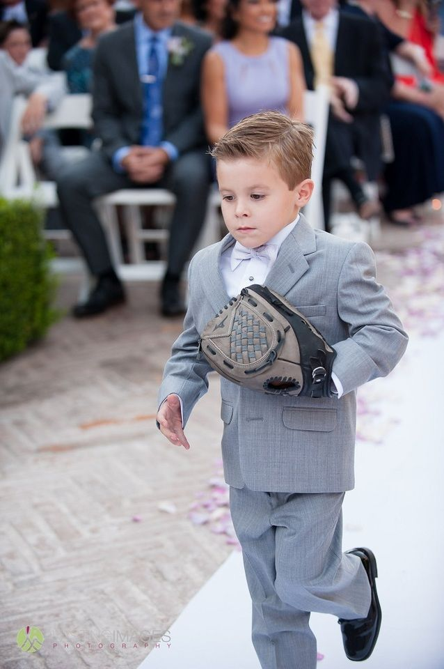 Adorable ring bearer in grey suit carries the rings down the aisle in his baseball mitt | Lasting Images Photography | villasiena.cc