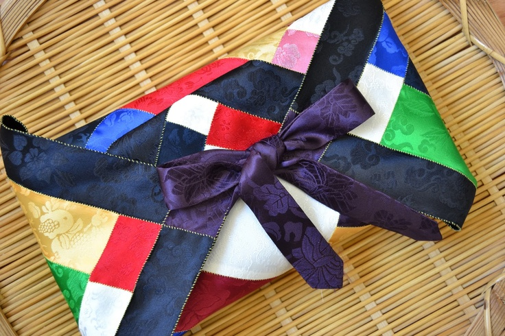 bojagi - beautifully wrapped presents with cloth. This one is wrapped with a color a pattern that feels traditional to Korea... I love this!