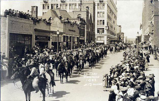 """1923 - The """"Calgary Stampede"""" merged with the """"Calgary Industrial Exhibition"""" to form the """"Calgary Exhibition & Stampede."""" Guy Weadick moved to Calgary to produce an annual Stampede at the same time as the Exhibition. He invented chuckwagon racing, downtown attractions and the other community activities that brand the Stampede today."""