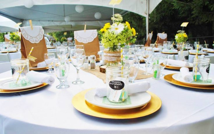 Gold, white and green guest table decor from real Vancouver, BC wedding. #createweddingsandevents #vancouverweddings
