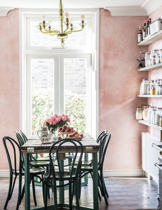 A sophisticated way to try the millennial pink trend in your home is a sponge paint technique in a traditional dining room.