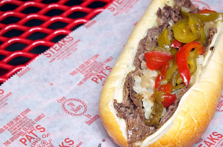 """Philadelphia, PA - Ask a group of Philadelphians where to get the best cheesesteak and you'll be lucky if you get anything close to a consensus. Everyone's got their own spot, and their own favorite combination of meat, cheese, and veggies. Pat's King of Steaks has the distinction of being the original, and they've got the lexicon down to a science: order """"with"""" for onions, and """"Whiz"""" for the goopy orange cheese topping that many locals prefer."""