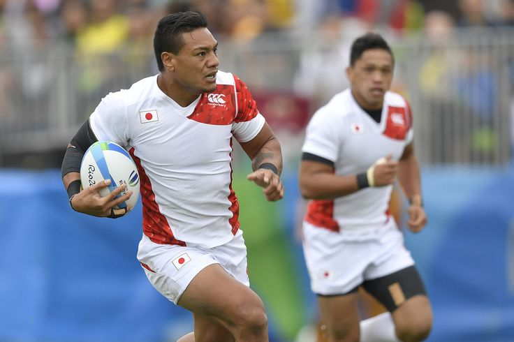 Japan's Lomano Lemeki scores a try in the mens rugby sevens match between Kenya and Japan during the Rio 2016 Olympic Games at Deodoro Stadium in Rio de Janeiro on August 10, 2016. / AFP / PHILIPPE LOPEZ