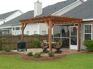 I'd like to have a pergola like this one off the back of my house.  I'd hang a porch swing on it...so it needs to be sturdy.