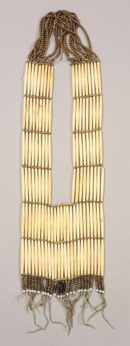 Central Plains Woman's Hairpipe Necklace    c. 1900   Bone hairpipes with rawhide spacers, gold painted wood beads at the neck and brass and glass beads off the bottom   1,998$ ~ Sold