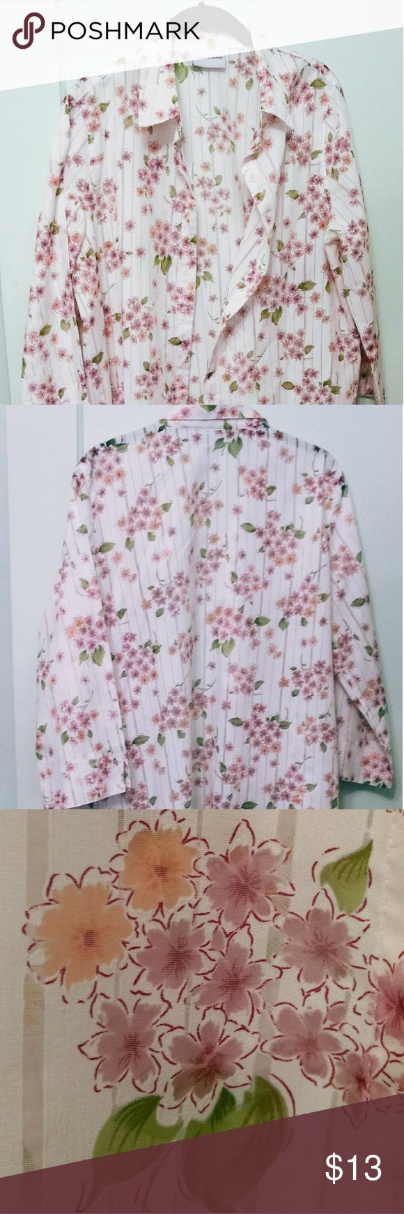 Alfred Dunner floral print burnout blouse This bright floral blouse has a white ground with peach, green, lavender green flowers and leaves. It has 3/4 sleeves and white buttons. There is an extra button on the left side. 55%cotton, 45% polyester. Care:machine wash, cold. Line?  dry. A fabulous spring or summer look with green or peach slacks. Alfred Dunner Tops Blouses