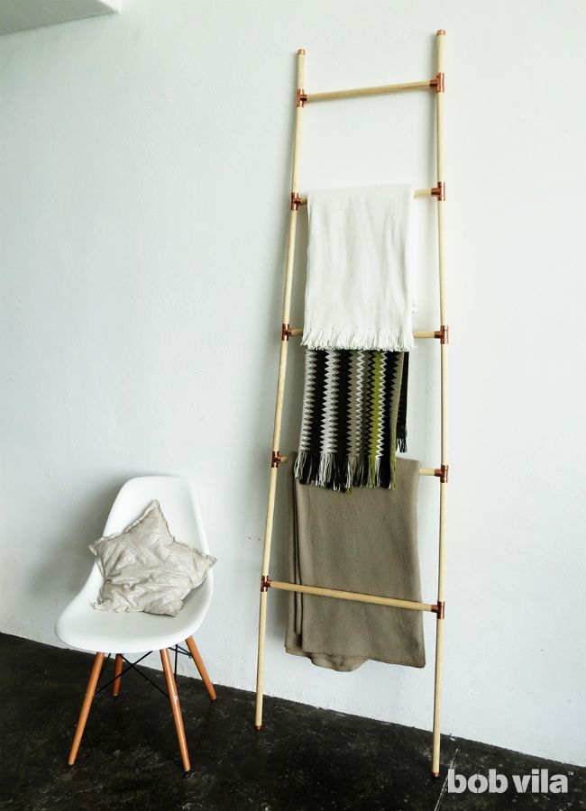 Decorative DIY ladder to display magazines or throw blankets
