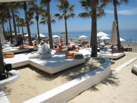 Nikki Beach, Marbella, Spain... this place has white beds and couches on the beach. Also a DJ and food/drink service! Sound like Heaven to me