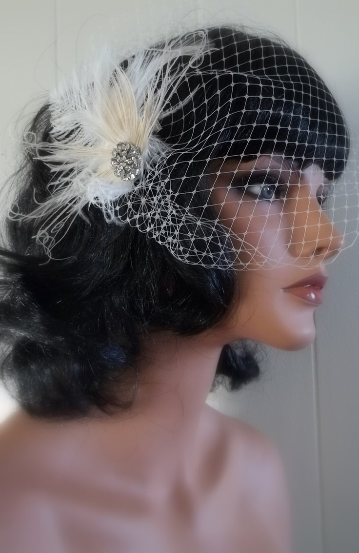 Ivory Cream Bridal Fascinator with Birdcage French Net Bridal Veil- Bleached Peacock, Ostrich Feathers, ship ready. $48,00, via Etsy.