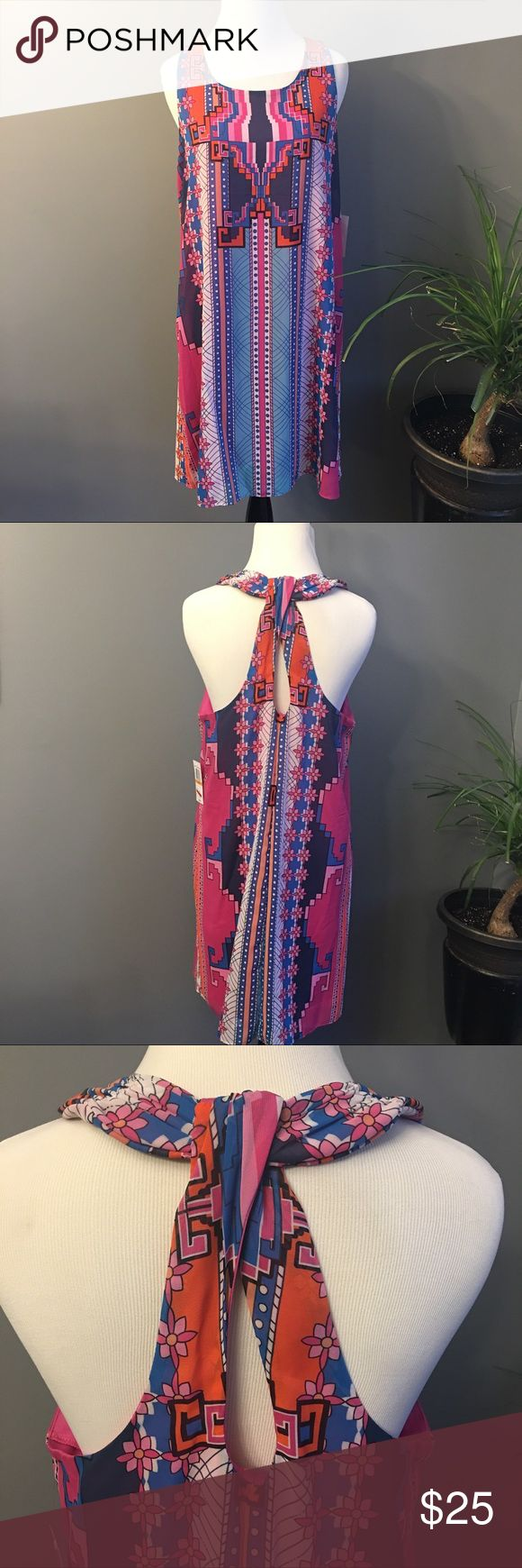 B Darlin dress New with tags B Darlin multi color dress with an adorable knotted style back. Size 7/8. Original price $39. Check out my page for more and ask about bundling to save some money. Make an offer! B Darlin Dresses Mini