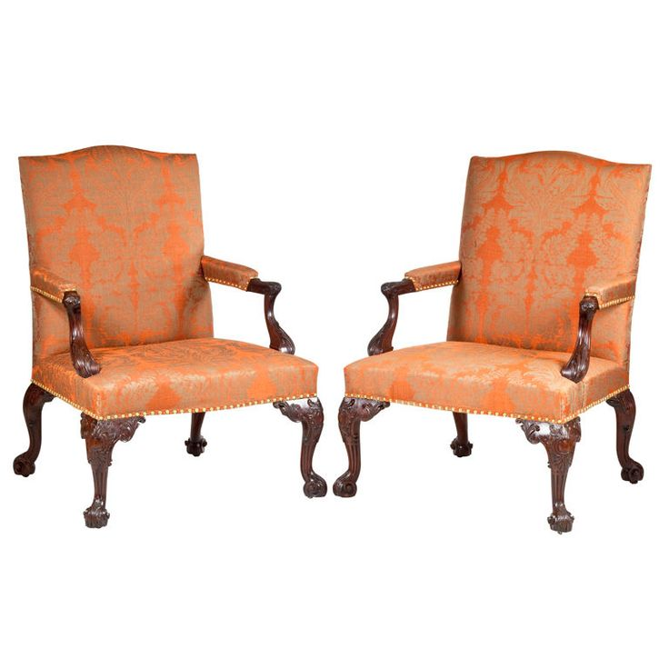 an important pair of george iii carved mahogany armchairs
