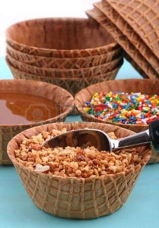 sundae toppings in waffle cone bowls Stock Photo