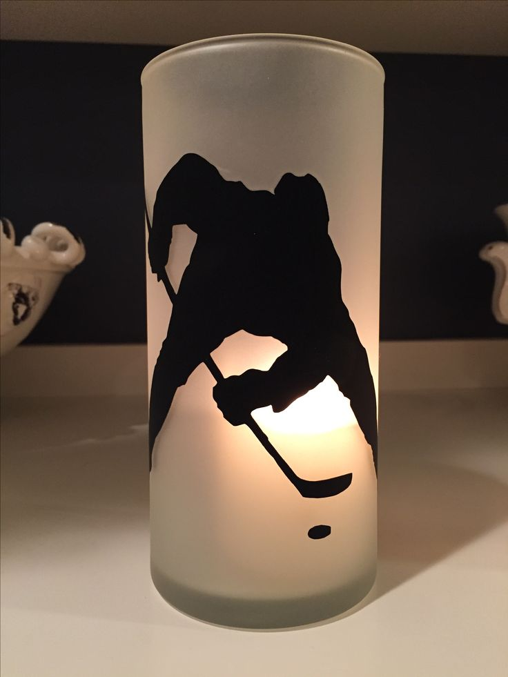 """Hockey vases created with dollar store vases, 6"""" hockey decal, and a can of frosted glass finish spray paint"""