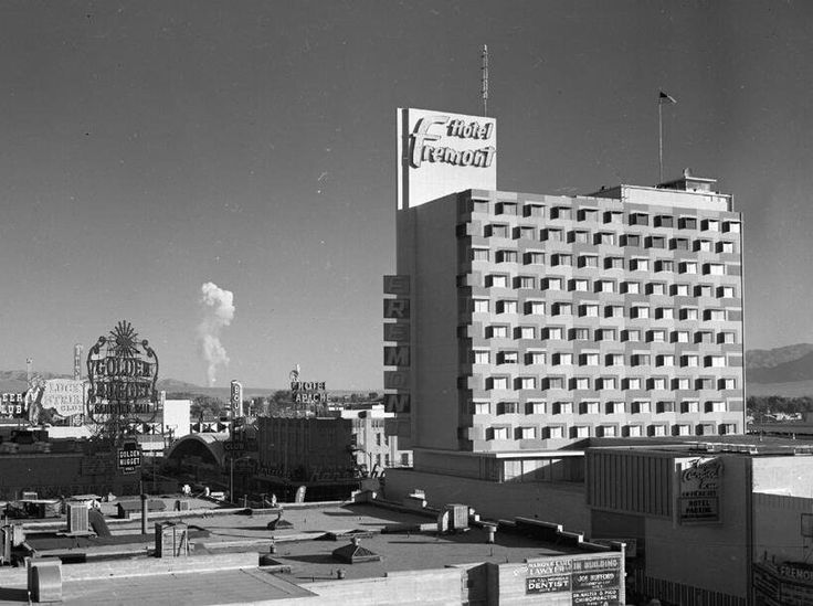 The Fremont Hotel in downtown Las Vegas, Nevada with a nuclear test mushroom cloud in the background on June 24, 1957 [819 × 611] : HistoryPorn