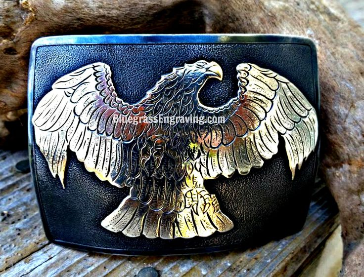 Custom mixed metal (nickel, brass and copper) eagle belt buckle, completely hand fabricated and hand engraved. Contact us for your own custom buckle!