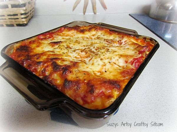 Mom's secret homemade lasagna recipe!  Makes enough for two dinners!  Freeze one, and you are set.  Great recipe!