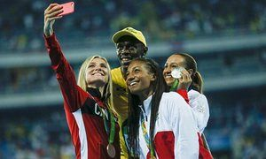 Usain Bolt with heptathlon medalists, from left, Canada's Brianne Theisen-Eaton, Britain's Jessica Ennis-Hill, and Belgium's Nafissatou Thiam.