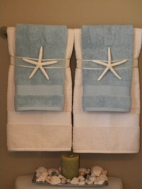 Interesting ideas for towel display, ways to decorate coffee tables, hanging artwork and color schemes