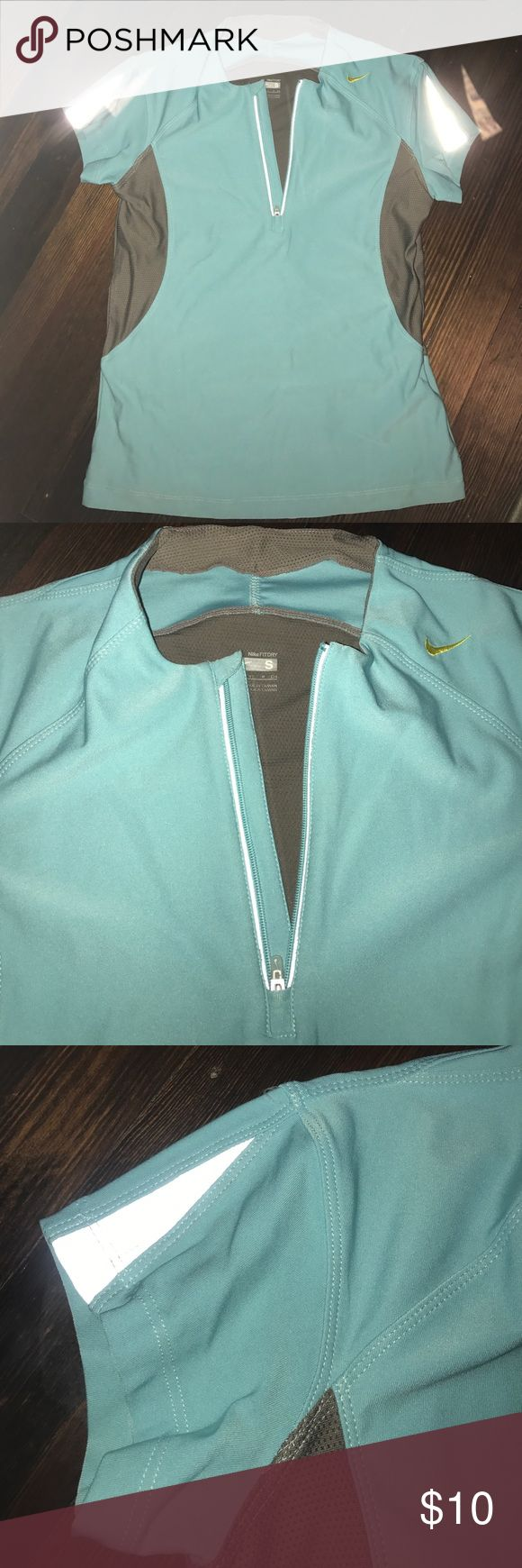 Nike Fit Dry top Tiffany blue Fitted Nike Dry Fit top with front zipper and reflective sleeves.  Pretty Tiffany blue color with grey.  Great condition! Nike Tops