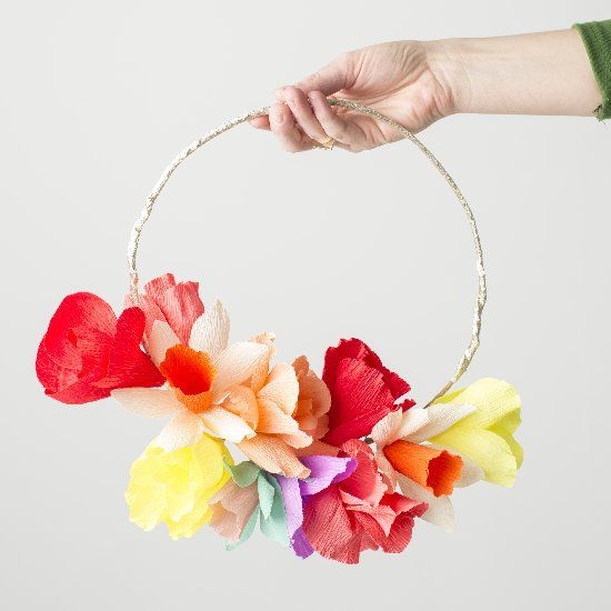 Learn how to make this paper flower rainbow wreath for St. Patrick's Day.