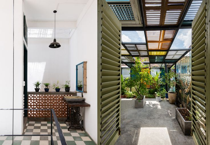 Vietnam's Vegan House is covered from top to bottom in vibrantly painted shutters