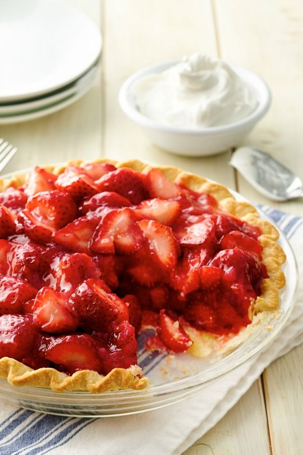 Enjoy this amazing strawberry pie topped with whipped cream!