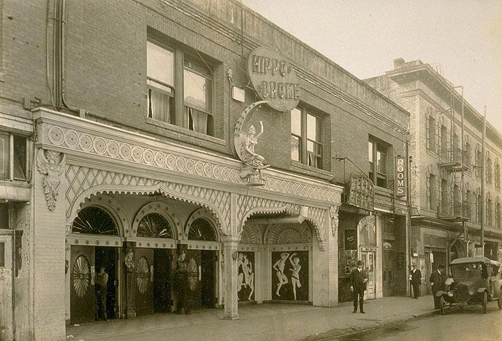 The Old Hippodrome and Bella Union Dance Halls at 557 Pacific Street between Kearny and Montgomery. Jesse B. Cook on sidewalk. Barbary Coast district, San Francisco. February 1925.